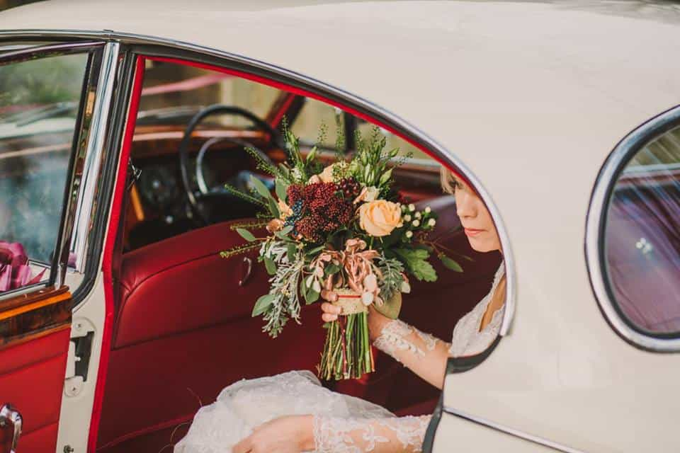 Getting out of the car - flowers in hand