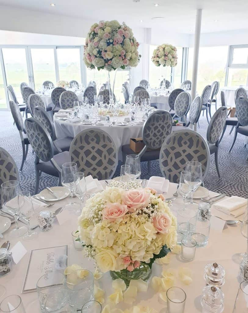 Table centrepieces - short and tall floral displays